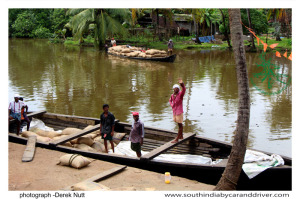 Kumarkom Backwaters riceboat unloading